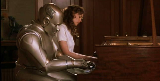 "Playing piano with a grown ""Little Miss"" in ""Bicentennial Man."""