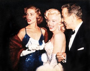 Bacall and Bogie flank Marilyn Monroe.