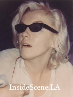 Marilyn in this photo, hides behind her sunglasses, including a black eye that is peeking out from beneath, that Dr. Ralph Greenson administered.