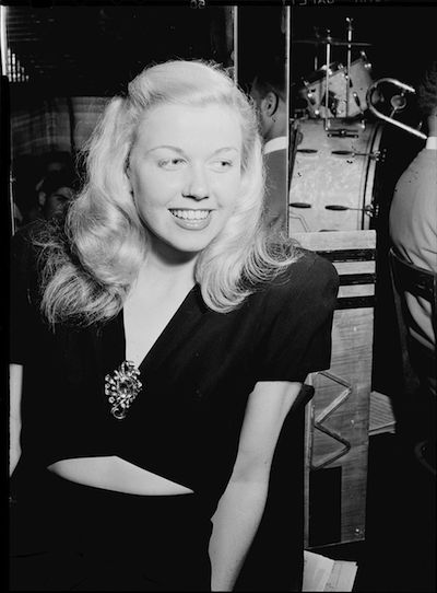 A beautiful photo of Doris Day in her early 20s, photographed in 1946, at the Aquarium Jazz Club in New York. Public Domain Image by William Gottlieb.