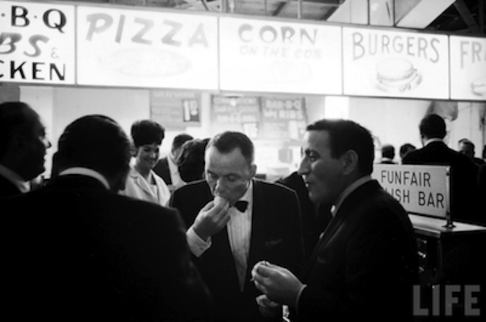 Frank Sinatra enjoying a hot dog with Tony Bennett. Image courtesy of LIFE.